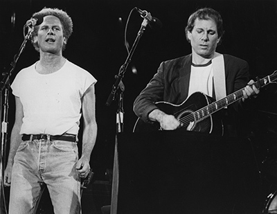 circa 1967:  Folk pop duo Art Garfunkel and Paul Simon, playing in front of more than 50,000 people in Madrid, at the start of their European tour.  (Photo by Central Press/Getty Images)