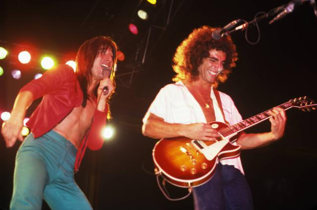Steve Perry and Neal Schon of Journey perform on stage in New York in 1980. (Photo by Richard E. Aaron/Redferns)